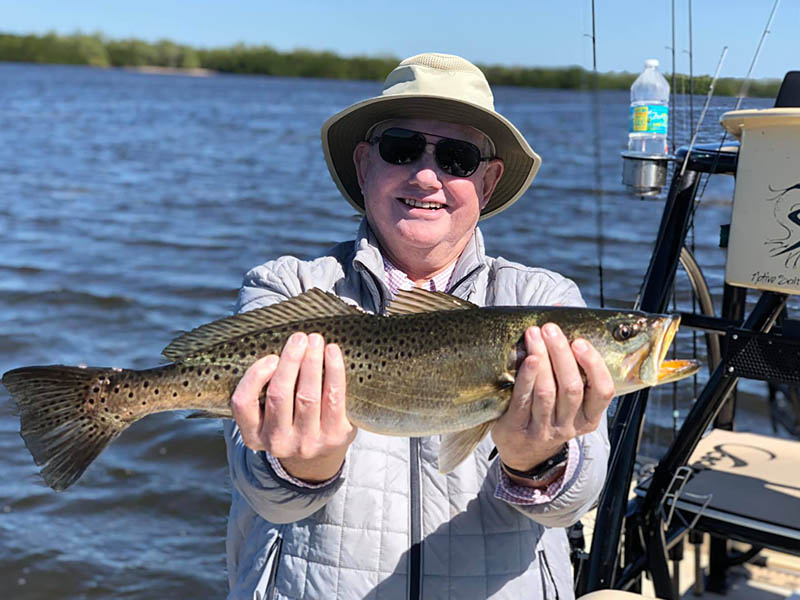 Happy angler with a Speckled Trout